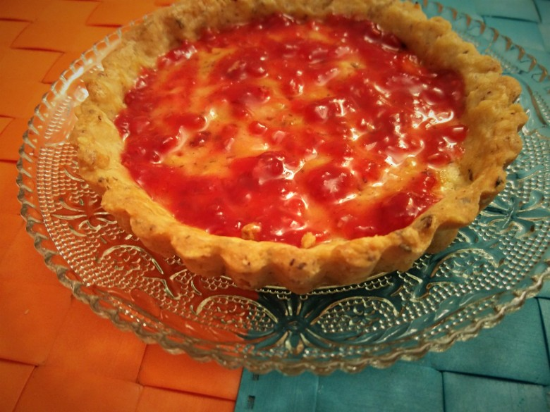 tart base with raspberry jam
